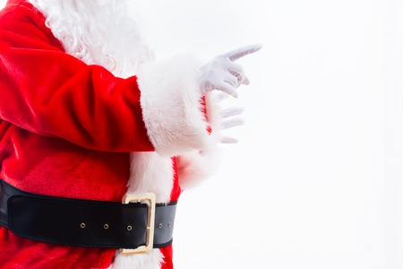 Santa with pointing gesture isolated on white background