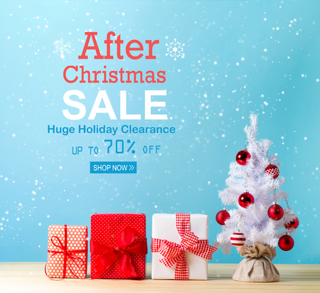 After Christmas sale message with a white Christmas tree and gift boxes Stock Photo