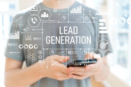 Lead generation with young man using a smartphone 免版税图像