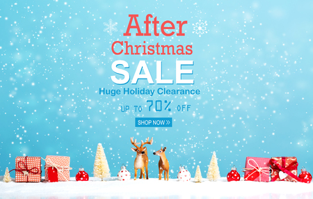 After Christmas sale message with reindeer and Christmas gifts in snowy day Stock Photo