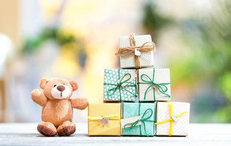 Christmas presents and teddy bear on a bright interior room background 版權商用圖片