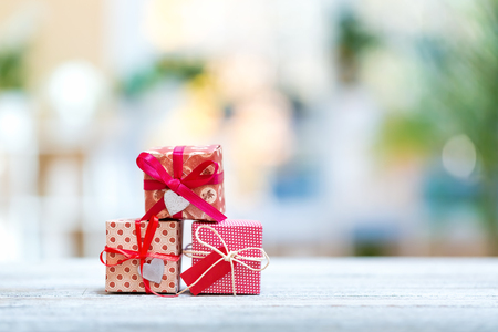 Christmas presents on a bright interior room background Imagens