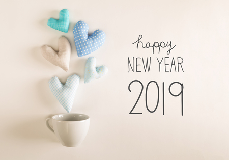 New Year 2019 message with blue heart cushions coming out of a coffee cup Stock Photo - 113093120