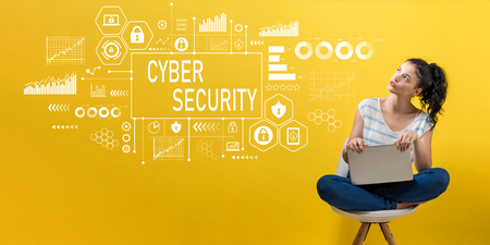 Cyber security with young woman using a laptop computer Stock Photo