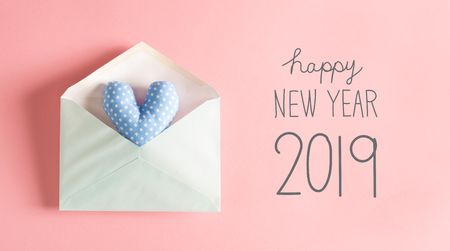New Year message with a blue heart cushion in an envelope Zdjęcie Seryjne
