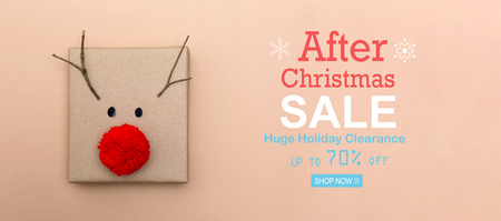 After Christmas sale message with a red nose reindeer gift box