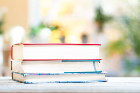 School textbooks on a bright interior room background