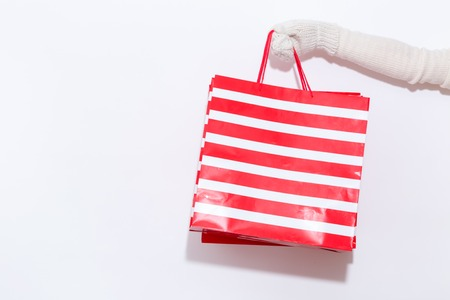 Woman holding a shopping bag on a white background