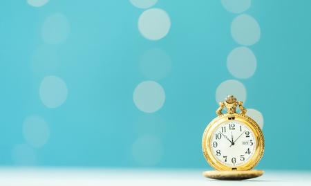 Old fashion pocket watch on a shiny light blue background Stock Photo