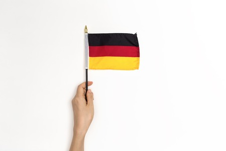 Person holding a German flag on a white background Standard-Bild - 113093691