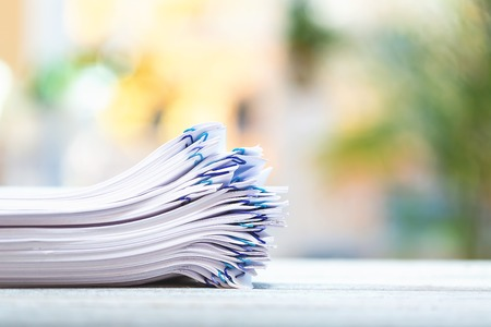 A big stack of documents on a bright interior room background Stok Fotoğraf - 113093702