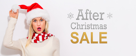 After Christmas sale message with happy young woman with Santa hat