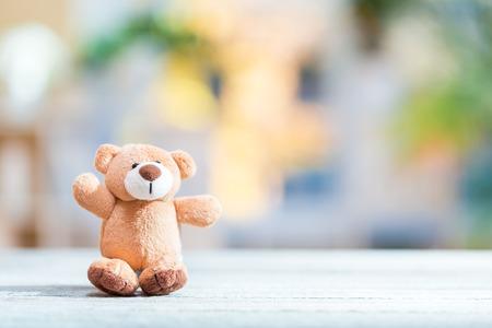 Cute plush stuffed teddy bear on a bright interior room background 版權商用圖片