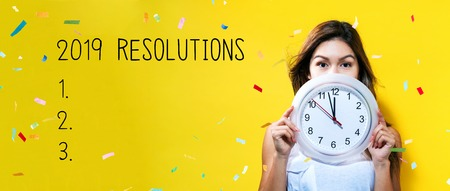 2019 Resolutions with young woman holding a clock showing nearly 12