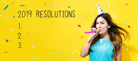 2019 Resolutions with young woman with party theme on a yellow background