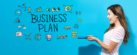 Business plan with young woman using her tablet