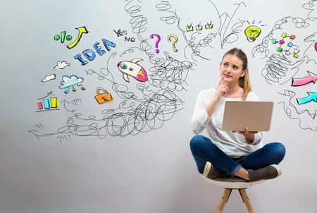 Many thoughts with young woman using her laptop on a grey background