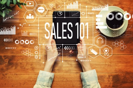 Sales 101 with a person holding a tablet computer Stock Photo