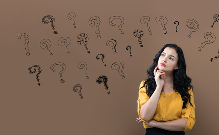 Small question Marks with young businesswoman in a thoughtful face Stock Photo