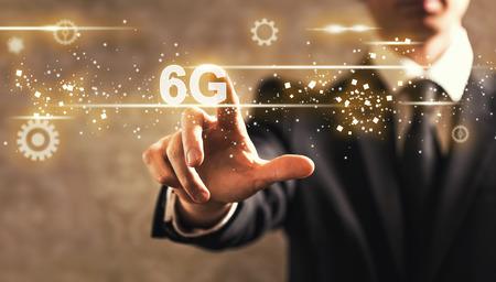 6G text with businessman on dark vintage background 스톡 콘텐츠