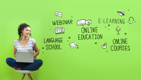 Online education theme with young woman using a laptop computer 版權商用圖片