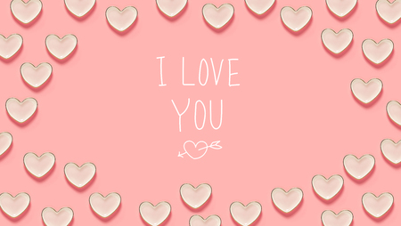 I Love You message with many heart dishes on a pink background