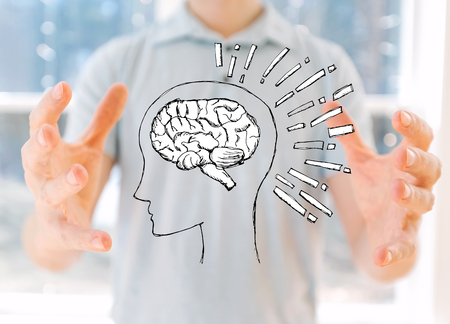 Brain illustration with young man holding his hands