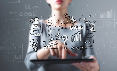 Business strategy ideas with business woman using a tablet computer Archivio Fotografico - 114588201