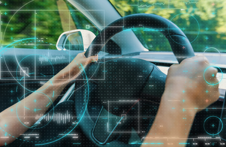 Person driving in a new high tech luxury car Stock Photo