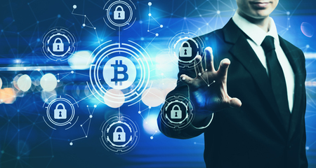Bitcoin Security Theme with businessman on blurred blue light background