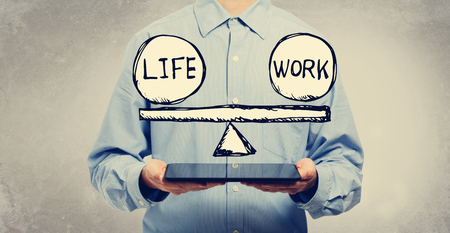 Life and work balance with young man holding a tablet computer Standard-Bild - 114760084