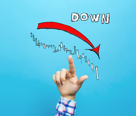 Market down trend chart with hand on a blue background 版權商用圖片