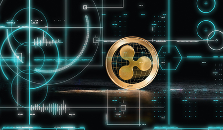 Ripple cryptocurrency coin on a dark background Stock Photo