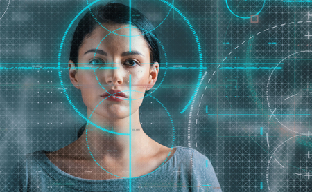 Portrait of a young woman with biometric technology theme 版權商用圖片
