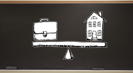 Work and life balance on a blackboard with erasers