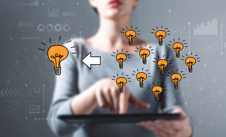 Many small ideas into one big idea with business woman using a tablet computer