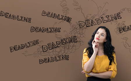 Deadline with young businesswoman in a thoughtful face