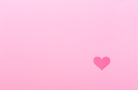 Pink heart on a pink paper background