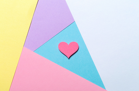 Pink heart on a pastel paper background Stock Photo