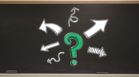 Question mark with arrows on a blackboard with erasers Stock Photo - 115165296