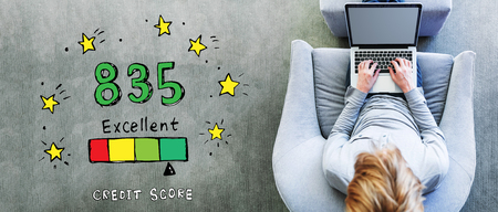 Excellent credit score theme with man using a laptop in a modern gray chair