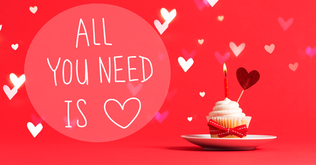 All You Need Is Love message with cupcake and heart ornament