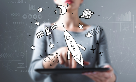Dream of space and rocket with business woman using a tablet computer Stock fotó - 115077821