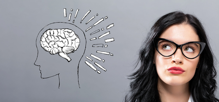 Brain illustration with young businesswoman in a thoughtful face