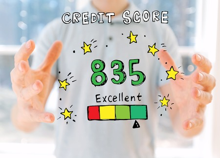 Excellent credit score theme with young man holding his hands Фото со стока