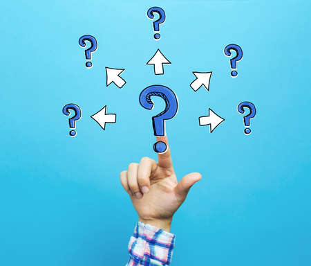 Big and small question marks with arrows with hand on a blue background