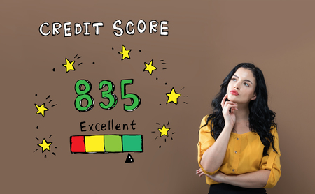Excellent credit score theme with young businesswoman on a brown background