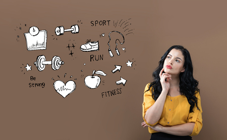 Fitness and diet with young businesswoman on a brown background Standard-Bild - 115462464