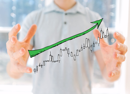 Market up trend chart with young man holding his hands 版權商用圖片