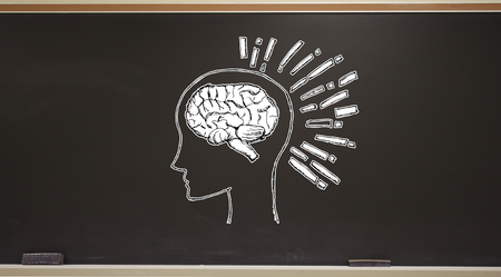Brain illustration on a blackboard with erasers